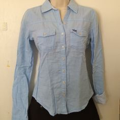 Abercrombie & Fitch Baby Blue Button-Up Beautiful baby blue color in a solid button up with blue and white pinstripe design on the inside (can see design on the outside faintly). Sleeves when rolled have the pinstripe design (like pic), but can be work not rolled. Accessories and/or other clothing are not included. Let me know if you have any questions. Thanks! Abercrombie & Fitch Tops Button Down Shirts