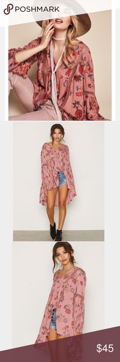 Free People Just the Two of Us Tunic Free People floral print swingy tunic styled with a flattering V-neckline, airy lace insets and pleated blouson sleeves. Tuck this bohemian-inspired piece in front, or wear it alone as a leg-flaunting mini. Semi-sheer; base layer recommended. 100% rayon. Re-posh, never worn by me but is pre-owned. Beautiful but didn't like the color on me. I will post actual pics soon along with measurements. Oversized fit, can fit XS to S. Free People Tops Tunics