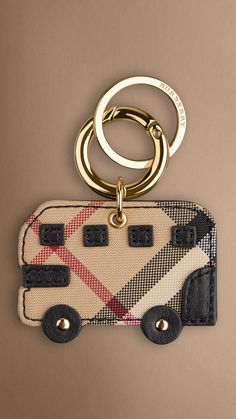 Iconic London bus key charm in Horseferry check with leather trim and reverse. Find the perfect gift this festive season at Burberry.com #burberrygifts #christmas