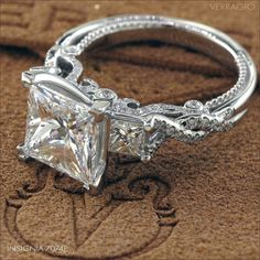 Princess cut center stone. This band is so gorgeous!! Love it