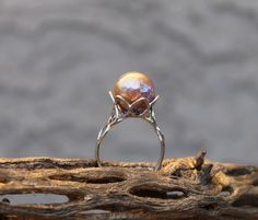 Check out this item in my Etsy shop https://www.etsy.com/listing/494984979/large-freshwater-pearl-solitary-ring