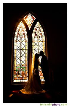 I love the silhouettes!  The stained glass is so gorgeous! ..i need a picture like this on my wedding day.