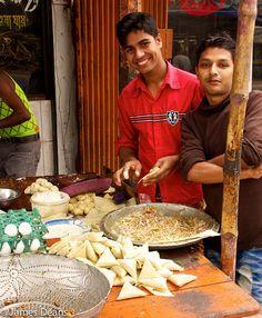 making samosas - street food in Dhaka, Bangladesh