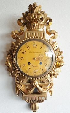 On eBay this Cartel Wall Clock Westerstrand Swedish Gilded Wood Case Sweden Bell…