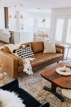 the ldl home: our living room reveal loving this gorgeous tan leather sofa in our new living room! Brown Leather Couch Living Room, Living Room Decor Brown Couch, New Living Room, Living Room Modern, Living Room Designs, Tan Couch Decor, Small Living, Brown Sofa, Living Area