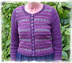 A colourful Fair Isle cardigan, with plain sleeves, knitted in Shetland 4 ply wool. Great for using up odds and ends.