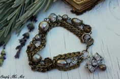Vintage Pearls, Glass Beads and layers of chains along with a Vintage Rhinestone Clasp Charm~ One of a Kind Creation Vintage Pearls, Vintage Rhinestone, Vintage Jewelry, Vintage Art, Vintage Bracelet, Vintage Ideas, Unique Vintage, Etsy Vintage, Vintage Clothing