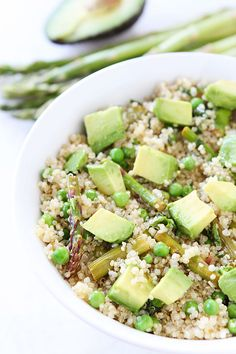 Healthy Quinoa Salad with Asparagus, Peas, Avocado & Lemon Basil Dressing on www.twopeasandtheirpod.com This simple healthy salad is perfect for spring!
