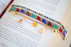 Our Bohemian inspired friendship bracelets are an eclectic mix of fine chains, beautiful glass crystal beads and bead loom work, made using an ancient Native American beading technique. Cleopatra, inspired by and named after the Ancient Egyptian Queen, is made with a detailed glass seed bead loom, gold plated rolo chain, silk thread tassels and quality glass crystal beads.