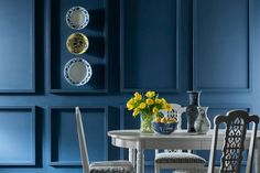 Richly saturated wall panels create a formal atmosphere and allow the white dining set to pop. | Classic Royal Blue, @Valspar Reserve