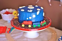train birthday cake. cookie crumbs and chocolate frosting to make a track around the perimeter for his new toy trains to sit on. Maybe pretzel sticks to make track?