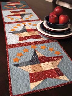 Add some Americana to your summer table with this mini charm and jelly roll friendly table runner!   This quick and easy table runner features small wool felt stars around larger patchwork stars. It's a great way to use mini charm squares or jelly ro...