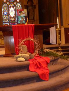 Palm Sunday altar decor. Crown of Thorns made from grapevine wreath with honey locust thorns fastened on with copper wire, the whole spraypainted with copper metallic paint to unify colors.