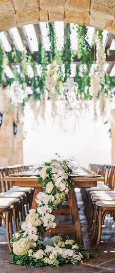 Vineyard Wedding... Garland orchids and hydrangea table runners