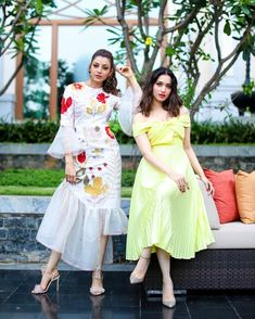 They are made of sugar and spice and everything nice. Stunning Kajal Aggarwal and Tamannaah Bhatia at a private Event. Kajal Agarwal on white color dress with floral print and net bell sleeves. Tamannaah in lie yellow color off shoulder dress. 11 May 2019 South Indian Actress, Beautiful Indian Actress, South Actress, Beautiful Actresses, Blazer Outfits, Chic Outfits, Tunic Designs, Indian Designer Wear, Bollywood Fashion