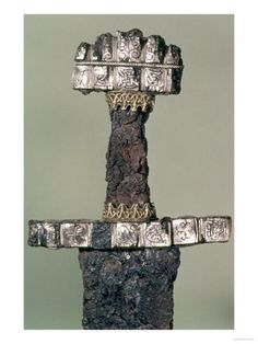 Google Image Result for http://imgc.allpostersimages.com/images/P-473-488-90/16/1632/S8FGD00Z/posters/hilt-of-a-viking-sword-found-at-hedeby-denmark-9th-century.jpg