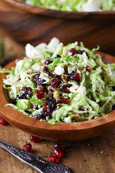 Shredded Brussels sprouts, crisp tart apples, feta cheese, cranberries, pomegranate arils and walnuts all tossed in a honey dijon vinaigrette. This makes a perfect side or lunch. Shaved Brussel Sprouts, Shredded Brussel Sprouts, Brussel Sprout Salad, Brussels Sprouts, Healthy Meal Prep, Healthy Cooking, Healthy Eating, Cooking Recipes, Salad Dressing Recipes