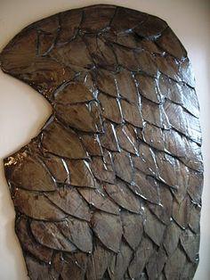 "Cardboard & paper mache used to make ""carved wood"" angel wings."