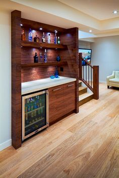 This in-wall bar makes a statement with the choice in wood but slips into its own space without being overpowering.