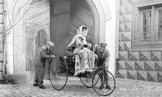 Bertha Benz and her two sons with a Benz Patent-Motorwagen in which she became the first person to ever drive an automobile over a long distance , 5th of August 1888