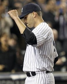 GAME 54: Tuesday, June 5, 2012 - New York Yankees starting pitcher Andy Pettitte pumps his fist as he leaves the game during the eighth inning of the baseball game against the Tampa Bay Rays at Yankee Stadium in New York. (AP Photo/Seth Wenig)