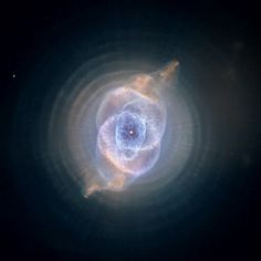 Out there in the universe - an eye.  The Cats Eye Nebula as taken by the Hubble Telescope.  Eerily beautiful.