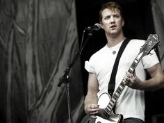 Josh Homme. Lead singer of QOTSA. That bicep needs to be my next meal...seriously.