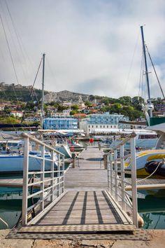 Yachts, sailing boats and pleasure boats are moored in marina of Balchik city in black sea coast at Bulgaria stock photo
