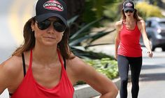 Stacy Keibler displays her impressive figure as she works up a sweat