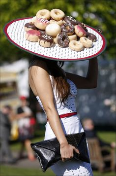 A doughnut hatted racegoer attends the Aintree Ladies Grand National horse at Aintree racecourse in Liverpool, England.
