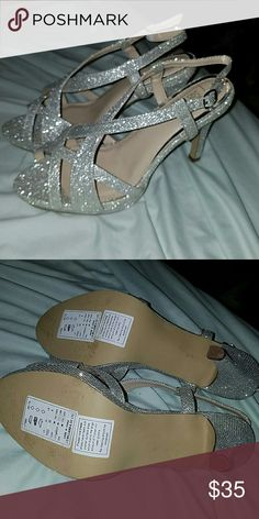 Beautiful silver heels Brand new 4 inch sliver glittery heels only tried them on had trouble walking in them lol Shoes Heels