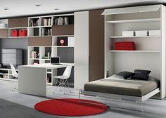#Dormitorio #juvenil con #cama #abatible vertical de 135x190, armario y librerías formando una composición con mesa de despacho dividiendo los espacios de día y de descanso.