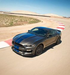 2018 Shelby GT350 taking a curve on a racetrack.