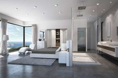 A surreal master bedroom with ocean view.
