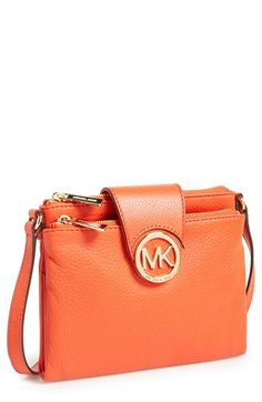 A cutout monogram anchors the two zip pockets that compose a soft leather crossbody bag designed with an accordion-pleat compartment at its center to stash cash and cards. Color(s): claret, fuschia, mandarin, raspberry, tan. Brand: MICHAEL Michael Kors. Style Name: MICHAEL Michael Kors 'Fulton - Large' Crossbody Bag. Style Number: 525775.'