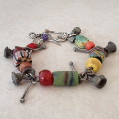 Sterling Silver Bracelet with Old Beads and Charms