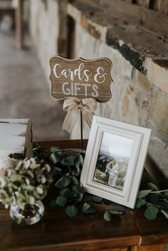 | modern rustic wedding decor | wooden cards + gifts wedding reception sign | modern rustic wedding reception decor | wedding decor with greenery | wedding decoration ideas | wedding welcome table ideas | outdoor wedding decor | photo taken at THE SPRINGS Event Venue. follow this pin to our website for more information, or to book your free tour! SPRINGS location:  Edmond, OK photographer:  Anna Bryan Photography #weddingdecor #weddingdecorations #outdoorwedding #outsidewedding…