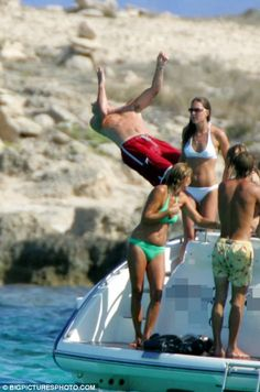 Kate and Pippa (white bikinis), Prince William (red shorts in water), James Middleton (yellow patterned shorts), Carole Middleton (green bikini)