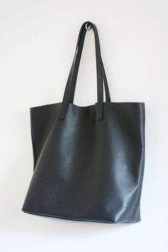 This black leather tote is perfect for everyday as well as for travel! Made from high quality pebbled Italian leather, the bag is soft and slouchy.