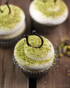 Vanilla Cupcakes with Honey Cream Cheese Frosting and sprinkled with ground pistachios.
