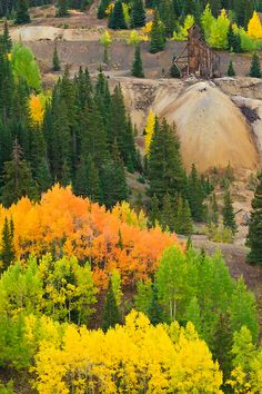 A mine with fall colors in Red Mountain Pass near Ouray, CO.