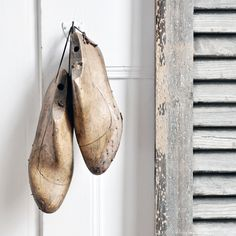 A pair of antique French wooden shoe forms