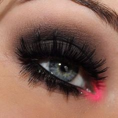 smokey eye with a vibrant pink in the tear ducts