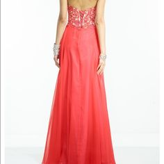 Red prom dress Red, size 10 or 12, beaded-top prom dress - never worn... Beautiful lace-up back. Dresses Prom