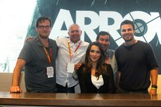 The men -- and woman -- of ARROW, one of fall's most-anticipated new series; from left: executive producer Andrew Kreisberg, executive producer Marc Guggenheim, star Katie Cassidy (in front), director and pilot executive producer David Nutter and star Stephen Amell (right) at the Warner Bros. booth at Comic-Con 2012 (© WBEI. All Rights Reserved.)
