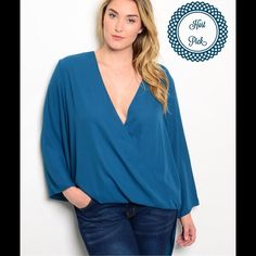 Teal Plus Top/CLEARANCE This gorgeous top features cross front panel and has a longer back panel. Long sleeves. 100% Polyester. (This closet does not trade or use PayPal ) Hot Ginger Tops