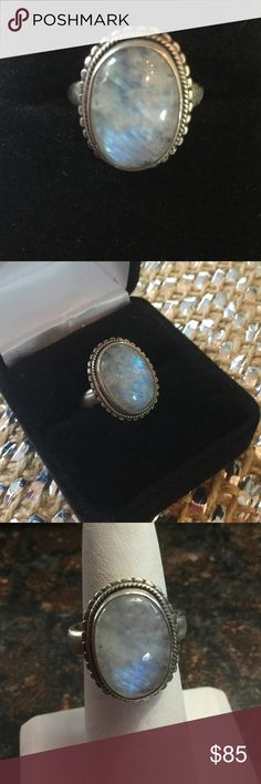 Genuine Blue Moonstone Ring Amazing opalescent genuine blue Moonstone  !  Set in in .925 silver in a nice weighty Sterling.  The Moonstone cabochon is just gorgeous with its natural fluorescent properties.  Beautiful rare genuine blue Moonstone, a great vintage find ! Estate Jewelry Rings