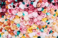paper flower backdrop, photo by Jessica Oh Photography http://ruffledblog.com/punk-rock-bridal-shower #weddingideas #backdrops