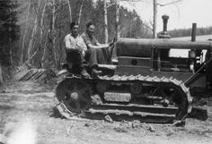 Two enrollees sitting on tractor, Camp Deer Lake, Civilian Conservation Corps :: Photographic Collections