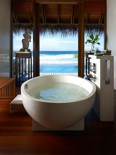 Maldives - Bathroom. At the Shangri-la-hotel.  How amazing and beautiful is this!!! One day Ill be bathing in there and relaxing my socks off not sure when but someday :) x
